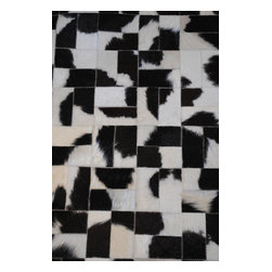 Diseno - Block pattern cowhide carpet, Natural Black & White Spotted, 4x6 - Simple and elegant, this classic take on brick pattern shows the natural variation of the hide color giving an overall marble effect.