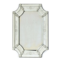Hollywood Regency - This gleaming mirror has a distinctive old world European flair. Its shapely silhouette, ornate glass carvings and vintage finish will transport you back to a more distinguished, regal time. Hang this mirror within your Hollywood Regency décor to add glamour to your foyer, or use as an antique accent above your vanity.