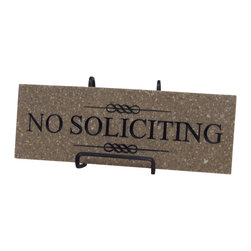 """Palmer Union Design - No Soliciting Sign, Wheat Sand - No Soliciting Sign is made from corian and black paint. There's a keyhole hanger carved into the back so you can easily hang it on your house or door. The No Soliciting Sign measures 3.5"""" x 10"""" and is a little under .5"""" thick. It's available in three different colors."""
