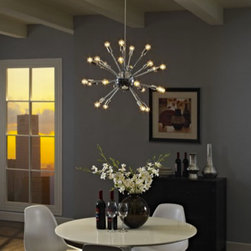 Gamut Chandelier in Silver - Center your focus with a blaze of light designed to illuminate spacious rooms and event areas. Whether you create a festive atmosphere with colorful or classic white bulbs, Gamut brightens every corner in this contemporary chandelier brimming with endless possibilities. The reflective metal base lends additional shine and sparkle to this eye-catching ceiling fixture.