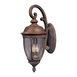 Maxim Lighting - Maxim Knob Hill DC Outdoor Wall Lantern - 19.5H in. Sienna - 3464CDSE - Shop for Wall Mounted from Hayneedle.com! The elegant style and brilliant light of the Maxim Knob Hill DC Outdoor Wall Lantern will draw guests right to your front door. This fixture has subtle leaf-and-vine details and a dramatic arched scrolled arm which give it the look of a bygone era. It is made of cast aluminum and seedy glass and finished in a rustic Sienna color. Mount it directly to the wall of your house or garage with the 4.5W x 9.5H-inch back plate. Rated for outdoor use; bulbs not included.About Maxim LightingSince 1970 Maxim Group Companies headquartered in California have been committed to providing a diverse selection of high quality lighting fixtures for your home. Maxim products are made with attention to detail and with all the latest advances in lighting technology as well as forward-thinking design policies that fit effortlessly into your life. Maxim's goal is to lead the lighting industry through integrity innovation and client satisfaction.