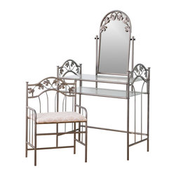 Coaster - Coaster Flower Pattern Vanity Table Set with Mirror in Nickel-Bronze Finish - Coaster - Bedroom Vanities - 2734 - Create your very own cosmetic corner with this Vanity Table Set by Coaster. This stylish personal table features a swiveling mirror and two glass shelves to hold a variety of products and accessories. Its real charm comes from the gorgeous leaf and vine motif fixed into the metal frame of the vanity. The stool is upholstered with faded flower square patterned fabric, and the metal frames of both table and stool are finished in nickel-bronze. Pamper yourself in style with this beautiful vanity table set by Coaster.