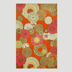Orange Disco Indoor/Outdoor Rug - This rug is so pretty. I love the modern floral print and the beautiful blend of colors.