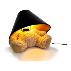 Suck UK - Teddy Bear Lamp - Is he a bear? Is he a lamp? Whichever way you choose to see him, he's weirdly wonderful. Let him win a place in your heart as he sits quietly on your shelf or bedside table. The black fabric-covered shade is a reflective gold on the inside to enhance Teddy's golden features. His plump body lets you park him where you please without fear of him toppling over. Poor Ted may have lost his head, but he definitely lights up the room!