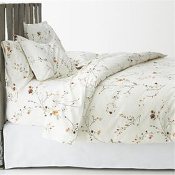 Sakura Full/Queen Duvet Cover - Ikebana inspiration for your personal space. A botanical pigment print in burnt oranges, greens and rust with brown branches is scattered across a soft white background. Reversible cotton duvet cover has flap closures. Duvet inserts also available.