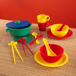 KidKraft - KidKraft Asian Cuisine Cookware Set - 63332 - Shop for Cooking and Housekeeping from Hayneedle.com! Chinese takeout is not nearly as much fun as making the same thing at home with the KidKraft Asian Cuisine Cookware Set. This Asian-inspired cookware and serving set gets kids thinking outside the norm with chopsticks special soup spoons and a rice steamer that aren't usually found in kitchen play sets. This set is quality crafted with composite wood for a fine-dining feel that your kids will get excited about. And its bright colors will help them set a fun table at which to practice their dining manners. This practice is part of an important form of play in which they imitate how they see adults act and interact around them leading them to develop crucial social skills that will stay with them for their entire lives. But all your child will notice and care about is Chi chi chi!About KidKraftKidKraft is a leading creator manufacturer and distributor of children's furniture toy gift and room accessory items. KidKraft's headquarters in Dallas Texas serves as the nerve center for the company's design operations and distribution networks. With the company mission emphasizing quality design dependability and competitive pricing KidKraft has consistently experienced double-digit growth. It's a name parents can trust for high-quality safe innovative children's toys and furniture.