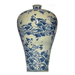 Chinoiserie Prunus Vase - Beyond blue and white: this classically shaped prunus vase features delicately carved light green dragons set against a geometric blue background.