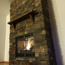 Twin Lakes, WI - Full start-to-finish project including wall framing, gas fireplace installation, and masonry. John W.