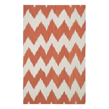 """Wild Chev rug in Saffron - """"Stripes are the greatest illusion maker in a designers toolbox. The chevron is classic and timeless, by playing with proportion and scale, my goal was to make it feel a bit refreshed and dressed up."""" - Genevieve Gorder"""