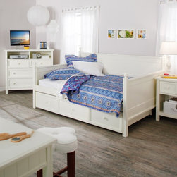 Fashion Bed Group - Casey Daybed - White - Full - RN743 - Shop for Daybeds from Hayneedle.com! Finally. A daybed you can really stretch out on. Found only at Hayneedle the Casey Daybed - White - Full takes the versatile daybed design and supersizes it. The full size offers plenty of room for sleeping reading and lounging in any room: guest room bedroom or office. Subtle cottage-style elements enhance the traditional design including rounded post finials and beadboard sides and back made of solid slats of wood. A crisp white finish covers the sturdy all-wood frame giving this daybed a stylish appearance to match its reliable construction. This exclusive full daybed comes with an optional twin-sized roll-out trundle drawer. Use it empty for blanket and linen storage or put up to an 8-inch-thick mattress inside to accommodate even more overnight guests. (Trundle does not pop up.) With or without the trundle your mattress will rest securely on the included wooden slat support system which is positioned 15 inches above the floor. Assembly required. Ships via common carrier. Dimensions: Daybed: 81.25L x 55W x 46H inches Side panel: 33H inches Finial ball: 3H inches Slat system: 15 inches above the floor Optional twin-size trundle: 76L x 40W x 13H inches About Fashion Bed GroupFashion Bed Group is a Leggett and Platt Company known for its innovative fashion beds daybeds futons bunk beds bed frames and bedding support. Created in 1991 Fashion Bed Group is a large consolidation of three leading bed manufacturers. Its beds are manufactured of genuine brass plated brass cast zinc cast aluminum steel iron wood wicker and rattan. Fashion Bed Group's products are distributed throughout North America from warehouses located in Chicago Los Angeles Houston Toronto and Ennis Texas.