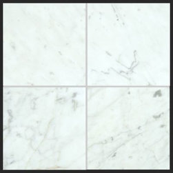 Stone & Co - Bianco Carrara 6x6 Polished Marble Tile - The Bianco Carrara collection or white Carrara Collection allows you to play with colors for your interior. Besides getting a lovely option of pure white on tile, this collection also features a white grey hue to try. With these two colors you can create a modern or classic looking theme in your home according to preference.Any plain looking house has a chance of being tweaked up by the right size and color in the Bianco Carrara or White Carrara collection. There is sophisticated inspiration about these tiles which will complement your high end European furniture, state of the art kitchen or a modernly designed bathroom. The possibilities of playing with size and color gives you an advantage of trying different options before deciding what suits you best.The Bianco Carrara floor tile collection not only upgrades your home, the ambience it creates speaks volume about your personality as well. Do you want your guests to go wow each time they walk into your home? Bianco Carrara collection is the renovation you are looking for!This collection is the answer to making your living room, kitchen or bathroom posh looking. The tiles are tough and durable, and we have the best experts to help you install the tiles.