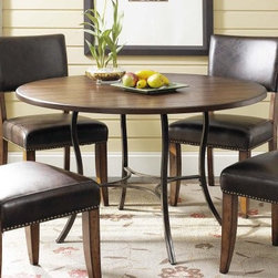 Hillsdale Cameron 5 Piece Round Wood and Metal Dining Table Set with Parson Chai - Add a beautiful contemporary centerpiece to your dining room with the Hillsdale Cameron 5 pc. Round Wood and Metal Dining Table Set with Parson Chairs. This dining table features flared metal legs and a wood top finished in chestnut brown. The chairs upholstered in brown faux leather are also finished in chestnut brown with a decorative nail head trim. This set seats up to four comfortably and provides an inviting place to gather for dinner. About Hillsdale FurnitureLocated in Louisville Ky. Hillsdale Furniture is a leader in top-quality affordable bedroom furniture. Since 1994 Hillsdale has combined the talents of nationally recognized designers and globally accredited factories to bring you furniture styling and design from around the globe. Hillsdale combines the best in finishes materials and designs to bring both beauty and value with every piece. The combination of top-quality metal wood stone and leather has given Hillsdale the reputation for leading-edge styling and concepts.