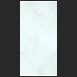 Stone & Co - Bianco Carrara 6x12 Polished Marble Tile - The Bianco Carrara collection or white Carrara Collection allows you to play with colors for your interior. Besides getting a lovely option of pure white on tile, this collection also features a white grey hue to try. With these two colors you can create a modern or classic looking theme in your home according to preference.Any plain looking house has a chance of being tweaked up by the right size and color in the Bianco Carrara or White Carrara collection. There is sophisticated inspiration about these tiles which will complement your high end European furniture, state of the art kitchen or a modernly designed bathroom. The possibilities of playing with size and color gives you an advantage of trying different options before deciding what suits you best.The Bianco Carrara floor tile collection not only upgrades your home, the ambience it creates speaks volume about your personality as well. Do you want your guests to go wow each time they walk into your home? Bianco Carrara collection is the renovation you are looking for!This collection is the answer to making your living room, kitchen or bathroom posh looking. The tiles are tough and durable, and we have the best experts to help you install the tiles.