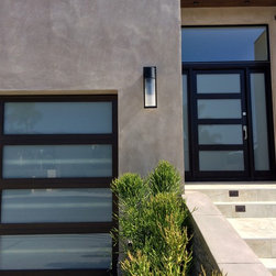Matching Garage Door and Entry Door in Corona Del Mar, California - •	Matching Garage door and Entry door