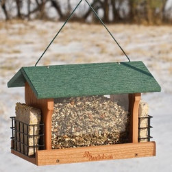 Going Green Recycled Plastic Large Ranch Bird Feeder with Suet Cages - Go green in more ways than one with the Going Green Recycled Plastic Large Ranch Feeder with Suet Cages in your backyard. This large-capacity bird feeder is an environmentally friendly option that also features an attractive ranch style. There's plenty of room for several birds with the double suet style. It is constructed from up to 90% recycled plastic with a green roof and a powder-coated perforated metal screen bottom for drainage. The new EZ Clean snap-out base makes it easy to clean too. Weight capacity: 5.5 lbs. Dimensions: 13.5L x 11.75W x 10.5H inches.About WoodlinkAt Woodlink a lot of pride goes into making innovative products that are friendly to the environment. The goal is to be as efficient as possible to serve the customer well. Every month Woodlink saves more than 37 trees 8 780 gallons of fresh water nearly 5.5 cubic feet of landfill space and 6 585 KWH of electricity. Woodlink is the exclusive licensee for the manufacturing of birding products to the design specifications of the National Audubon Society.