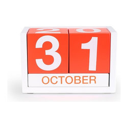 Block Calendar in Orange - Get up close and personal with the passing days. This block calendar includes a block for each month and day. Simply flip each block accordingly and never forget the day's date again.