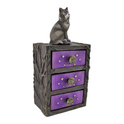 Majestic Wolf 3 Drawer Miniature Chest - This miniature chest of drawers is a wonderful accent to any room. It has 3 small drawers for stashing keepsakes, and features a gray wolf on the top to protect your treasures. Made of cold cast resin, this piece measures 9 1/4 inches tall, 4 1/4 inches wide, and 3 inches deep. It is hand painted to emphasize the wonderful details, from the wood grain and tree branches to the intricate Celtic knotwork drawer pulls. This piece looks lovely on tables, dressers, and mantels, or is perfect for paperclips and small desk items.