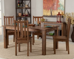 Belham Living Townsend Rustic Wood Dining Table Set - Add the character of rugged, rustic furniture to your dining room or kitchen with the Townsend Rustic Wood Dining Table Set. This solid wood table is large enough to seat up to six people, so you can gather the whole family around its warm multi-step rustic wood finish. The weathered appearance highlights all of the discrepancies and lines of the wood, making this table a real charmer to anyone with a sweet tooth for rustic flavor. You have the option of adding either 4 or 6 Townsend Dining Chairs to complete the look and bring as many people as you choose to your big, rectangular table. Table dimensions: 66L x 38W x 30.5H inches. Chair dimensions: 18W x 20D x 41H inches. A special note on the unique quality of this itemSolid wood is used in the construction of this item rather than pre-manufactured MDF or veneers. For this reason, each piece will be truly unique. Wood knot placement will vary and each item will have its share of rough and smooth surfaces. Each product is truly one of a kind. Dimensions: Table: 66L x 38W x 30.5H inches Chair: 18W x 20D x 41H inches About Belham LivingBelham Living builds catalog-quality furniture in traditional styles at a price that actually makes sense. By listening to our customers and working closely with great manufacturers, we build beautiful pieces worthy of your home. Rich wood finishes, attention to detail, and stylish lines that tie everything together are some of the hallmarks of a Belham Living piece. From the living room or bedroom, through the kitchen, and out onto the deck, there's something from an incredible Belham collection perfect for your style.