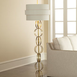 "Horchow - Circular Motion Floor Lamp - Symmetrically pleasing lamp employs a series of stacked brass rings to create the illusion of motion. From the John-Richard Collection. Handcrafted. Eggshell-colored silk shade with gold foil lining. Uses one 150-watt bulb. 20""Dia. x 70.5""T. Impor..."