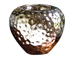 Rain Vase - 10 x 12 - Dimpled with texture to create a smooth effect reminiscent of the first drops of water falling upon parched earth, the Rain Vase is finished in a glamorous metallic silver so its quiet, serene effect can be incorporated into any decor where the concentrated light of a strong metallic can create a reflective focal. Rounded in form, the vase has a nipped-in mouth for both visual interest and easy arranging.