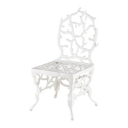 Currey & Co - Currey & Co 4148 Corail White Chair - The Currey & Co 4148 Corail White Chair has the appearance of a coral reef. The Corail accent chair is made of cast aluminum wrought iron. The chair can be used outdoors since it is resistant to weathering, but it can just as easily be used indoors to make a stunning addition to a sitting room. The Corail Accent Chair pairs well with the 414 Corail Console Table in White.
