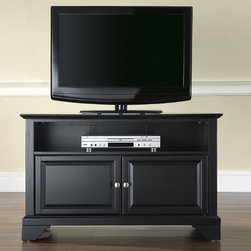 "Crosley - LaFayette 42"" TV Stand - Enhance your living space with one of Crosley's impeccably-crafted TV stands. This signature cabinet accommodates most 42'' flat panel TVs and is handsomely proportioned featuring character-rich details sure to impress. Raised panel doors strategically conceal stacks of CDs/DVDs, gaming components and various media paraphernalia. Open storage area generously houses media players and the like. Adjustable shelving offers an abundance of versatility to effortlessly organize by design, while cord management systems tame the unsightly mess of tangled wires. Customize our distinct cabinets by selecting one of four collection styles (featuring tapered, traditional. turned or bun feet) in your choice of one of three signature Crosley finishes. This customizable cabinet approach is designed for easy assembly, built to ship and constructed to last. Features: -Raised panel doors.-Adjustable shelf for storing electronic components, gaming consoles, DVDs and other items.-Adjustable levelers in legs.-Recommended TV Type: Flat screen.-TV Size Accommodated: 42"".-Powder Coated Finish: No.-Gloss Finish: No.-Material: Hardwood and veneers.-Solid Wood Construction: No.-Distressed: No.-Exterior Shelves: Yes -Number of Exterior Shelves: 1.-Adjustable Exterior Shelves: No..-Drawers: No .-Cabinets: Yes -Number of Cabinets: 1.-Number of Doors: 2.-Door Attachment Detail: Pin hinge.-Interchangeable Panels: No.-Magnetic Door Catches: Yes.-Cabinet Handle Design: Knob.-Number of Interior Shelves: 1.-Adjustable Interior Shelves: Yes..-Scratch Resistant : No.-Removable Back Panel: No.-Hardware Finish (Finish: Black): Brushed nickel knobs, steel hardware.-Hardware Finish (Finish: Classic Cherry, Vintage Mahogany): Antique brass knobs, steel hardware.-Casters: No .-Accommodates Fireplace: No.-Fireplace Included: No .-Lighted: No .-Media Player Storage: Yes.-Media Storage: No .-Cable Management: Hole in back for wires.-Remote Control Included: No.-Batteries Required: No .-Weight Capacity: 200 lbs.-Swatch Available: No.-Commercial Use: No.-Collection: Alexandria.-Eco-Friendly: No.-Recycled Content: No .-Lift Mechanism: No.-Expandable: No.-TV Swivel Base: No.-Integrated Flat Screen Mount: No.-Hardware Material: Steel.-Product Care: Use a soft clean cloth that will not scratch the surface when dusting. Use of furniture polish is not necessary. Should you choose to use a furniture polish, test in an inconspicuous area first. Use os solvents of any kind could damage your furniture's finish. To clean, simply use a soft cloth moistened with lukewarm water, then buff with a dry soft clean cloth..Specifications: -ISTA 3A Certified: Yes.-FSC Certified: No.-General Conformity Certified: No.-CSA Certified: No.-EPP Certified: No.Dimensions: -Overall Height - Top to Bottom: 26"".-Overall Width - Side to Side: 42"".-Overall Depth - Front to Back: 18"".-Drawer: .-Shelving: Yes.-Cabinet: -Cabinet Depth - Front to Back: 14.75""..-Legs: Yes.-Overall Product Weight: 71 lbs.Assembly: -Assembly Required: Yes.-Tools Needed: Allen wrench (included) and screwdriver.-Additional Parts Required: No .Warranty: -Manufacturer provides a 3 month warranty against defects in material and workmanship.-Product Warranty: 90 days."