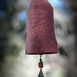 "Rustic Garden Bell - This handmade clay wind chime features a beautiful carved starburst pattern, accented by a large copper wind-sale with a patina finish. A small clay bird sits atop. My wind chimes serve so many purposes, besides just beautiful garden décor. They alert you to the severity of the wind that day, will scare off birds and animals that you don't want in your garden, and will create a peaceful, zen-like sound for the outdoors with it's wooden clapper (hear their sound on the YouTube clip below). Makes a perfect wedding or housewarming gift. Unglazed stoneware clay fired to 2200 degrees makes it very durable. Bell length 6 1⁄2 to 7 1⁄2"". Total length 13"" to 14"". 2 1⁄2"" W. 6"" hanging chain included. Handmade in the USA."