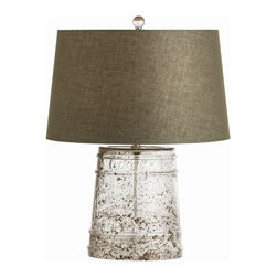 Arteriors - Dunlap Lamp - Why not make a statement with your home lighting? The beautifully speckled glass makes this lamp base a work of art while casting a warm glow through its cotton moss-colored shade. The two mediums work together to create that special intersection where form meets function.