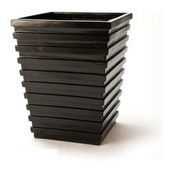"""Escalon Fiberglass Planter - This contemporary and very modern planter is fabricated from fiberglass and painted a deep black. Standing nearly 25"""" in height, this Escalon black fiberglass planter would be stunning on either side of a door way, or placed in a visually strategic area on a patio or deck. There are many benefits of Fiberglass material; durability, strength and resistance to weathering, to name a few. These benefits in turn mean minimal maintenance for your planters. The Escalon black fiberglass planter has been formed with interesting details, from the horizontal ridges and the tapered shaped of the planter."""