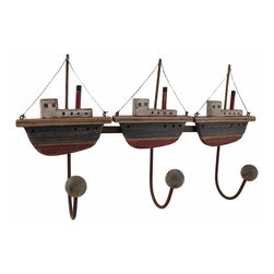 Zeckos - Wood and Metal Fishing Boats 3 Hook Wall Rack - This decorative wall hook features three distressed finish wooden fishing boats. Each fishing boat holds a metal hook with a wooden ball on the end, perfect for hanging robes and towels in a bathroom, belts and purses in a bedroom, or keys and leashes in an entryway. It measures 17 1/2 inches long, 10 inches high and 4 1/4 inches deep. It easily hangs using two nails or screws from the round metal loop hangers on the back.