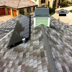 GAF Grand Slate II Shingle Roof with Solar Installation - Orange, California - Section of a 7.488 kW rack mounted solar system, installed over a GAF Grand Slat II shingle on the sloped section of a home in Orange, CA. This solar system was installed by Chandler's Roofing and leased through OneRoof Energy.