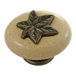 Hickory Hardware - Country Casual Windover Antique with Oatmeal Oval Cabinet Knob - A rustic elegance is characteristic of this look. Elements have a handmade, forged metal quality. Some pieces look as if they were bought in antique shops.