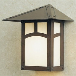 EW-7 Arroyo Craftsman Evergreen Small Outdoor Sconce - A subtle blend of Swiss Chalet, English Tudor, and California Mission styles are skillfully married in Arroyo Craftsman's Evergreen series with five choices of filigrees and decorative overlays. Every item in the series is offered with your choice of the classic arch overlay, pine needle, sycamore, t-bar, as well as empty. The hummingbird filigree is offered on items with frames nine inches or larger.