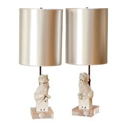 Vintage Foo Dog Lamps - This is a great DIY project. They have added lucite bases and metallic shades to a pair of vintage foo dogs to create these great lamps.
