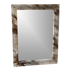 MyBarnwoodFrames - Rustic Mirrors Bunkhouse Barn Wood Mirror with Tacks, 18 x 22 - Rustic  Mirrors  With  Country  Charm  -  Bunkhouse  Style  Barn  Wood  Mirror  with  Tacks,18x22          Rustic  Mirrors  handcrafted  from  natural  barn  wood  are  our  specialty.  We  especially  like  this  unique  mirror  which  features  a  wide  3.5  inch  barnwood  frame  face.  We've  added  distressed  nail-head  tacks  all  the  way  around  the  outside  of  the  wood  frame,  which  makes  this  a  unique-looking  mirror  that  adds  character  and  charm  to  your  western  rustic  or  primitive  decor.          The  mirror's  exterior  dimensions  are  18x22  inches,  and  you  can  hang  your  mirror  either  horizontally  or  vertically.          This  mirror  can  be  manufactured  in  custom  sizes.  Please  call  888-OLD-BARN  for  a  quote.
