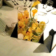 Yellow orchid & cala lily centerpiece
