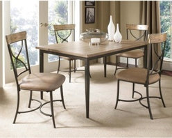 Hillsdale Charleston 5 Piece Rectangle Desert Tan Wood Dining Set with X-Back Ch - With a rustic yet sophisticated style the Hillsdale Charleston 5 pc. Rectangle Desert Tan Wood Dining Set with X-Back Chairs enhances any dining room. A light desert tan wood finish on the table and chair backs perfectly complement the dark gray metal table legs and chair frames. Gently flared chair legs and sandy brown easy-care faux leather upholstery complete this set's contemporary look. About Hillsdale FurnitureLocated in Louisville Ky. Hillsdale Furniture is a leader in top-quality affordable bedroom furniture. Since 1994 Hillsdale has combined the talents of nationally recognized designers and globally accredited factories to bring you furniture styling and design from around the globe. Hillsdale combines the best in finishes materials and designs to bring both beauty and value with every piece. The combination of top-quality metal wood stone and leather has given Hillsdale the reputation for leading-edge styling and concepts.