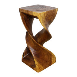 Kammika - Double Twist Stool Sustainable Wood 12x12x26 inch Ht w Livos Eco Friendly Walnut - Our Sustainable Monkey Pod Wood Double Twist Stool 12 inch x 12 inch x 26 inch height with Eco Friendly, Natural Food-safe Livos Walnut Oil Finish is a visual delight in any setting. It has graceful one-quarter turns will add a sense of serenity and beauty to your home. You can use it as an end table, stand or stool; two together can serve as a striking coffee table. A single piece of Monkey Pod wood finished with Livos Walnut oil, these eco friendly functional art pieces are appealing to the viewer from any angle. Each piece is a Work of Art! Craftspeople from the Chiang Mai area in Northern Thailand create these pieces with the simplest of tools. Sustainable Monkey Pod wood (Acacia, Koa, Rain Tree grown for wood carving) is dried, carved, sanded, and rubbed in Livos Walnut oil polished to a water resistant and food safe matte finish. Color ranges from medium to dark Walnut brown tones that will darken as the wood ages. These natural oils are translucent, so the wood grain detail is highlighted. There is no oily feel, and cannot bleed into carpets. Made from the branches of the Acacia tree, where each branch is cut and carved to order (allowing the tree to continue growing), the wood is kiln dried, carved and sanded, creating a beautiful, sturdy and sustainable stool. We make minimal use of electric hand sanders in the finishing process. All products are dried in solar or propane kilns. No chemicals are used in the process, ever. Each eco friendly functional art piece is packaged with cartons from recycled cardboard with no plastic or other fillers. The color and grain of your piece of Nature will be unique, and may include small checks or cracks that occur when the wood is dried. Sizes are approximate. Products could have visible marks from tools used, patches from small repairs, knot holes, natural inclusions or holes. There may be various separations or cracks on your pi
