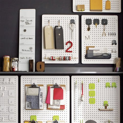 Three by Three Peggy Board Storage - Do you love peg boards? This one at Crate & Barrel helps keep everything organized.