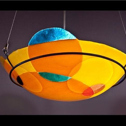 """Neymark, Shel - Circles Pendant - This festive looking pendant will lend a whimsical air to any room!  The  shade is made by slumping art glass at an extremely high temperature  while """"fusing"""" (or melting) ornamental circles of other glass colors to  the bowl.  Each piece is a work of art made and signed by one of our  highly skilled studio glass artists"""
