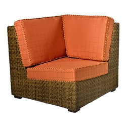Woodard - Domino Wicker Corner Lounge Chair (Thayer) - Fabric: Thayer. With cushions. Inhibitors added to prevent mildew growth and fading from the sun (UV stabilized). Stretch resistant - unsurpassed tensile strength resists sagging or stretching. Soil and scratch resistant - protected against soiling and abrasion from normal usage. Easy to maintain with a solution of water and mild detergent. Made from wicker. Seat height: 18 in. H. 29.5 in. W x 35 in. D x 34 in. H (45 lbs.). All products are made to order. Orders cannot be cancelled after 5 calendar days. If order is cancelled after 5 calendar days, a 50% restocking fee will be appliedSupreme comfort and generous dimensions give this space-saving outdoor lounge a deserved spot in your porch or patio lineup. Both wicker frame and soft cushions have customized color options. Armless corner chair add flair & exotic appeal to your porch, poolside and elsewhere.