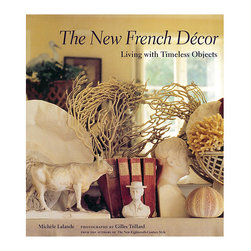 Ballard Designs - New French Decor - The art of setting, compiling, or combining disparate objects is a difficult art, yet it has become the chic new decorating style in France, and is now spreading throughout the world. After the success of The New Eighteenth-Century Style, journalist Miche Lalande and photographer Gilles Trillard team up once again to showcase the most successful combinations of treasured heirlooms and contemporary design. From mundane objects like seashells and glass bottles to priceless works of master craftsmanship, The New French Dor provides insight into the blend of sophistication, symmetry, confusion, and minimalism that makes each of these rooms successful.