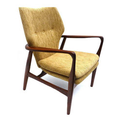 Handmade Retro Delight Chair - Upgrade any space to modernized retro stylings with this handmade Retro Delight Chair. Its unique and sleek design, with its smooth yet dramatic angles, will make you and guests swoon. Its simple button-tufted backrest and long-lasting upholstered cushioning rest over a beautifully durable teak frame, making it great for any reading nook, bedroom, or dining room.