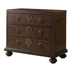 Frontgate - Tortola Chest - Covered in rich chocolate leather that will beautify over the years. Three drawers, detailed with nailhead trim and custom-crafted ring pulls and keyhole escutcheons in an aged bronze finish with a copper undertone. Side handles provide a well-traveled aesthetic. Coordinates with other items from our Tommy Bahama Kingstown collection. If memories only get better with years, then our Tortola Chest is the ideal receptacle for storing all of yours. Wrapped in rich chocolate leather and decorated in nailhead trim, it has the look of a refined piece that has been lovingly embellished over a well-traveled life. The classic three-drawer style and bun feet provide a sturdy canvas for the ornate keyhole escutcheons and custom drawer pulls, while handles on each side of the chest hint that another adventure - or use - may be right around the corner.  .  .  .  .