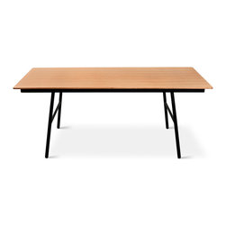 Gus* - School Dining Table - School Dining Table  by Gus Modern  At A Glance:       A modern interpretation of the classic elementary school table, featuring an engineered wood top for structural integrity, overlaid with gorgeous Oak or Walnut veneer. With a base that's sturdy and durable - and black powder-coated so it backs out of the picture and lets the top shine - this dining table matches the School Chair perfectly.  What's To Like:  The School Table fits in well with the modern industrial or minimalist aesthetic. Concrete floors, exposed metal beams, huge glass windows ... and black powder coated legs.Stable construction makes this one of the best tables for a growing family.  What's Not to Like:  Aesthetically speaking, you'll find a lot to like - unless you want your table to be fully made of wood. You folks (and you know who you are) probably won't dig the black metal base.   The Bottom Line:   The School Dining Table by Gus Modern isn't