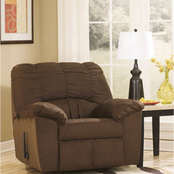 "Ashley - Dominator Rocker Recliner in Cafe Fabric - With rich earth-toned upholstery and a plush comfort you can really sink into, the ""Dominator-Cafe"" upholstery collection features thick padded arms and a beautifully detailed stitched bustle back design that makes this collection the perfect fit for any living area. Contemporary Plush Recliner; Infinite Reclining Positions; Lever Recliner; Plush Upholstered Arms; Cafe Fabric Upholstery; Bustle Back Cushions; CA117 Fire Retardant Foam; Durable Frame Construction; Metal drop-in unitized seat box for strength and durability; Corners are Glued, Blocked and Stapled; Upholstery pre-approved for wearability and durability against AHFA Standards; Cushion core constructed of low melt fiber wrapped over high quality foam; 100% Polyester; Spot clean with water based cleaner; Overall Dimension?: 42""W x 39""D x 40""H;"