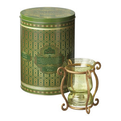 Everybody's Ayurveda - Pitta Jar Candle Holder - Metal - Pitta Balancing Jar Holder: One gold-tone metal jar holder. Holder lifts candle off the surface so air can circulate around the candle. Symbolizes cooling while the holder design symbolizes the boundaries and stability pitta doshas need to achieve balance. Candle in decorative tin sold separately. Package Includes: Candle Holder Only. Dimensions: Length: 5.5 inch. Width: 6.75 inch. Height: 7 inch.