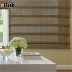 Bali Economy Woven Wood Shades From Blinds.com in Curaco Loden - Pictured in Curaco Loden, these beautiful woven wood shades are made from bamboo reed, bamboo slat, sisal and grass cloth, jute and straw materials. They add natural color, texture and dimension to your windows and create a comfortable atmosphere of casual elegance or simple sophistication.