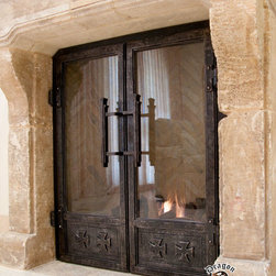 Fireplace Doors - Designed and forged by Craig May.  This project had a crusaders cross theme that we used through the designs.  Functional glass doors