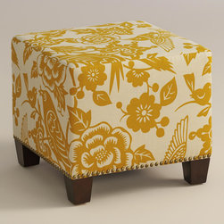 "World Market - Maize Canary McKenzie Ottoman - Cozy up with our custom-made Maize Canary McKenzie Ottoman, handcrafted in the U.S.A. with cotton blend upholstery and nail head trim. Showcasing a stylized canary and floral motif in a muted maize hue, this plush ottoman makes a bold statement. Pair two ottomans for a dramatic ""bench"" at the foot of the bed. Shop our coordinating bed or headboard in the same custom fabric for a pulled together look."